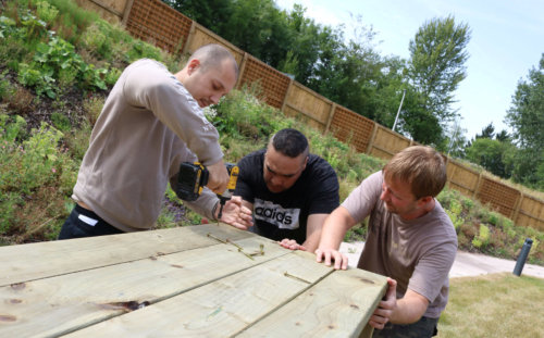 mental health service users build raised beds for growing at North Manchester General Hospital